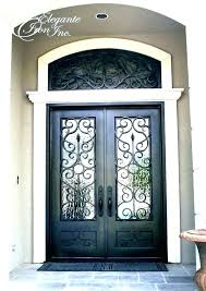 front door with arched window above a doors high ceilings crown molding and an blinds front door with arched window