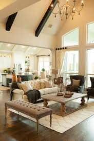 home fabrics and rugs with traditional living room and beige sofa rectangular coffee table chandelier ceiling beams tufted bench