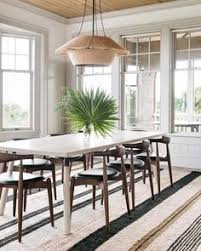 dining room with a view to the ocean nickey kehoe string lantern pendant light