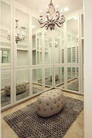 image mirrored closet. marie flanigan interiors chic closet with floor to ceiling mirrored doors and travertine tile floors image