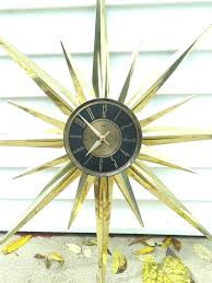 wall clocks vintage sunburst wall clock rare metal atomic starburst battery works elgin