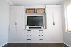 master bedroom built ins with a mounted television