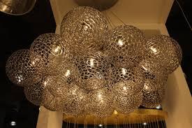 shakuff perforated glass globe chandelier