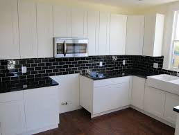 kitchen backsplash white cabinets dark floors