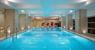 hotel indoor pool. After A Busy Day, Swim In The Heated Pool And Enjoy Your Time Relaxation Area With Chaises Longues Towels. Hotel Indoor