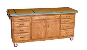 a rolling workbench with cabinets and drawers