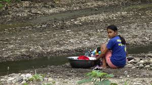 woman washing clothes by hand.  Hand Filipino Woman Hand Washing Clothes At A River In The Philippines Stock  Video Footage  Videoblocks Throughout Woman Washing Clothes By Hand O