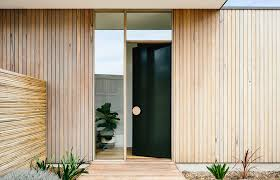 front door design idea use an oversized circular door handle for a unique look