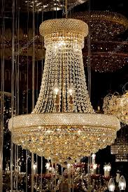 contemporary glass chandelier isolated over black background photo by art9858