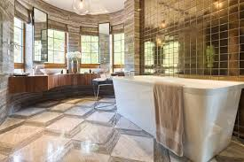 luxury bathroom with marble floor tile and gold mosaic tile