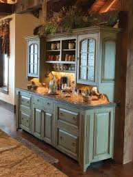 sage green chalk painted credenza hutch with decorative bushes for italian styled kitchen ideas with open shelves