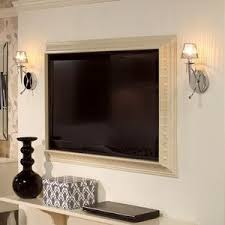 flat screen tv on wall. make a frame out of crown molding to mount around your flat screen tv that hangs tv on wall e