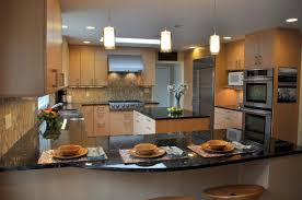 White Galaxy Granite Kitchen Brown Cabinetry With White Island Also Black Galaxy Granite