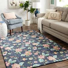 dark midnight navy blue provides a rich base color for the modern pink yellow and green watercolor inspired fl motif of mohawk homes verdant area rug
