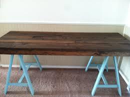 plan rustic office furniture. rustic dark sawhorse desk with blue legs and cozy berber carpet plus white baseboard plan office furniture