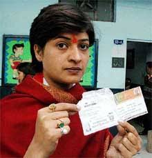 Congress candidate for the Motinagar Assembly constituency Alka Lamba shows a voter slip alleging it as a violation of the election rule, at a polling booth ... - nt7