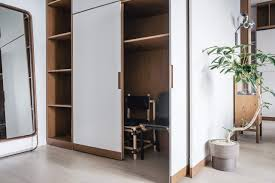 furniture for studio apartment. White Cupboard Storage Of A Contemporary Hong Kong Studio Apartment | NONAGON.style Furniture For M