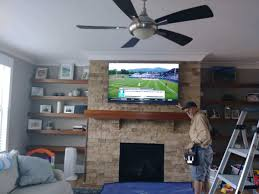 you might have heard that mounting a tv over a gas fireplace can damage tv or cause neck strain neither is true if by chance you re thinking about
