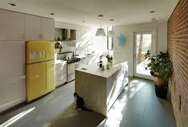 white fridge in kitchen. fridge play-button · white in kitchen