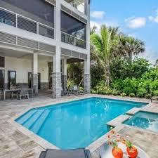 pool design ideas. Island Style Backyard Custom-shaped Hot Tub Photo In Miami Pool Design Ideas