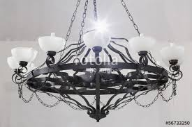 vintage chandelier with candles in room with white walls