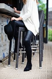 the motherchic wearing leather leggings and poncho