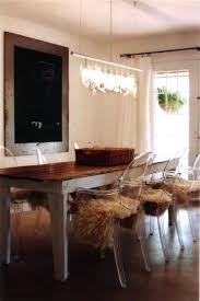 glass dining table with ghost chairs. contemporary condo dining room with glass table ghost chairs t