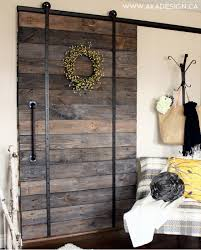 diy pallet sliding barn door and diy track feature from aka design life