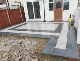 PrimaPorcelain - A work in progress! We love this patio's black and white  pattern, creating using our Bodmin Anthracite and Clifton White porcelain  paving. Visit our website to order your free samples!