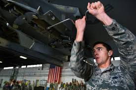 u s department of defense photo essay air force airman 1st class cody howard tightens a bolt on an f 16cm fighting