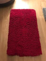 small red plush rug size 60cm x 110cm