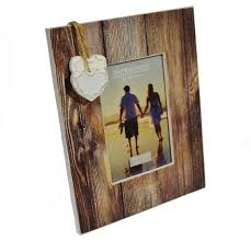 distressed wood photo frame with hanging hearts