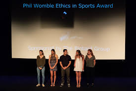 athletes on stage at awards ceremony
