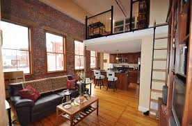 View in gallery A simple mezzanine level transforms the apartment into a  loft
