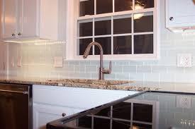 white glass subway tile kitchen backsplash traditional kitchen