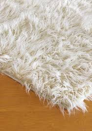 ivory mongolian lamb faux fur rug design with wooden floor for contemporary family room design