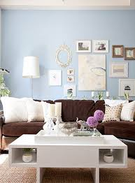 decorating living with and loving a brown sofa blue walls brown furniture