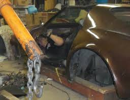 sportscar salvage upside down and backward in a corvette to remove a wiring harness