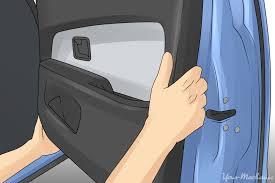 hands replacing the door panel