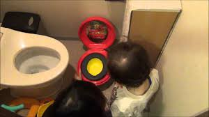Potty Training Toilet Aden Looking At His New Cars Kiddie Toilet