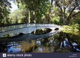 bridge and pond in the gardens at magnolia plantation gardens near charleston south ina usa