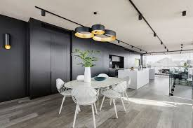 the white dining table matched the white kitchen island and the black and gold pendant