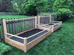two raised bed gardens fence trellis