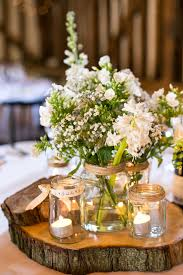 Centerpiece from our wedding (Navy blue) mason jars filled with baby's  breath, votives, and moss, on wood slices for a diy cute centerpiece. Black