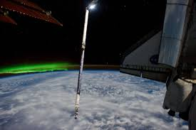 southern lights greet iss and atlantis