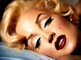 marilyn monroe wore this look alot and it s probably her signature look and involves a matt beige eyeshadow a cool brown eyeshadow and black liquid