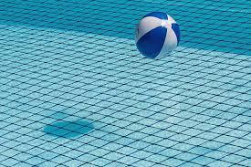 swimming pool beach ball background. Swimming Pool Safety Net Beach Ball Blue Water Background
