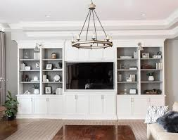 white living room built in shelves with