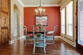 L Minimalist Dining Room Design With Round Shape Wooden Table And Red Wall  Color Also Laminated Floor Decorating Idea