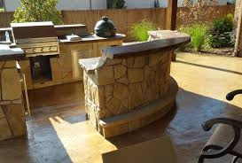 custom outdoor patio with a kitchen and grill